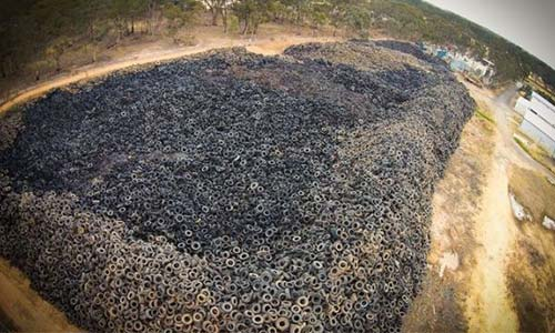 Stand-off over fees between nine million tire pile owners and Australian Government