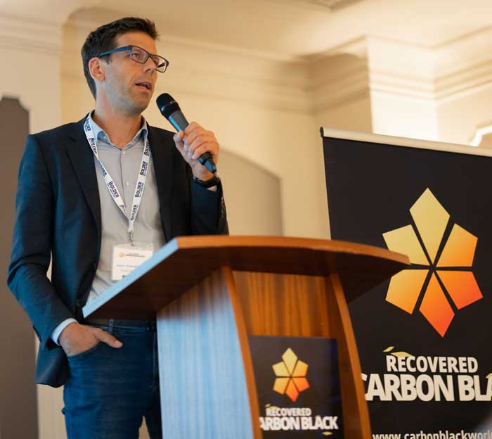 Robert Weibold speaking at Recovered Carbon Black conference in Berlin
